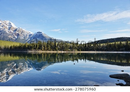 Perfect reflection of Pyramid mountain in Pyramid Lake in Jasper National Park, Canada, UNESCO World Heritage site