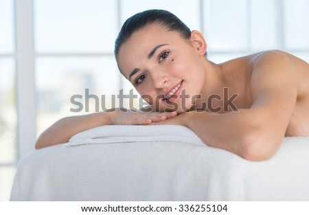Perfect relaxation in spa salon. Young woman in a spa is relaxing and waiting for medical massage treatment