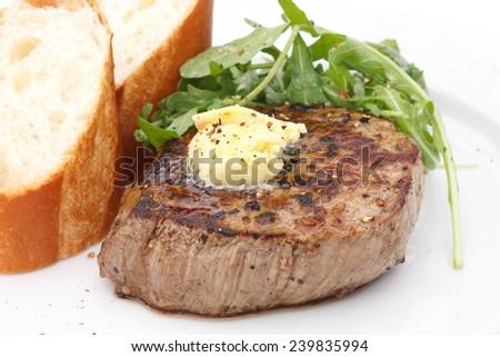 Perfect roast pork tenderloin fillet steak topped with melting butter. - stock photo