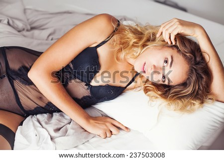 perfect sensual portrait of a gorgeous woman in black seductive underwear - stock photo