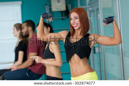 Perfect shape in a gym. Young and beautiful girl is having training on a exercise bike.. Active workout. Healthy sportsmen concept
