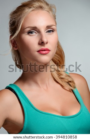 Perfect skin and make-up. Charming young face. Close-up portrait of a blonde model. - stock photo