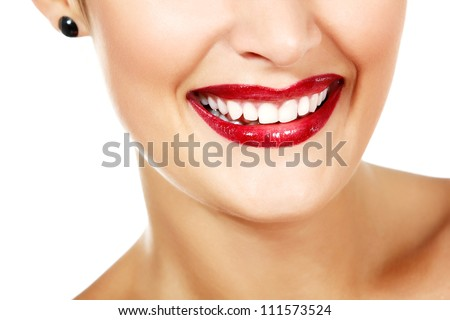 Perfect smile of young gorgeous fresh woman with vivid red lipstick and white health teeth, face detail. Isolated over white background