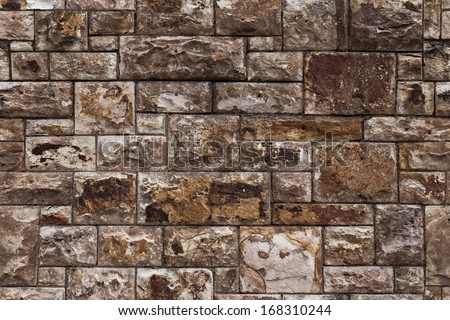 Perfect stone wall. This photo has been altered to make a seamless tessellating image which can be repeated without any visible join. - stock photo