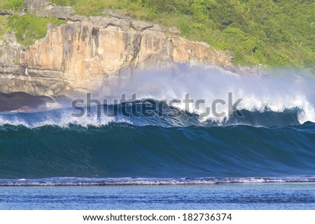 perfect surfing wave in Indonesia. Sumbawa island. - stock photo