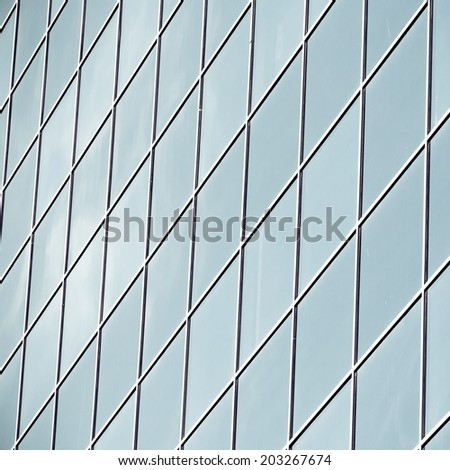 perfect texture of blue glass high-rise corporate buildings and industrial skyscrapers in business office center - stock photo