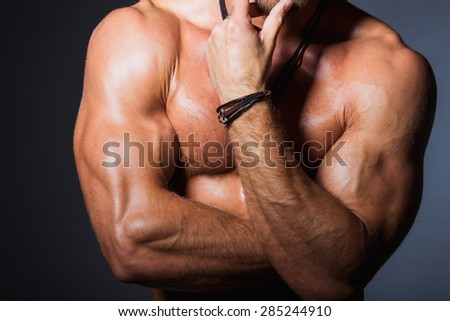 Perfect torso of young fitness man with strong biceps - stock photo