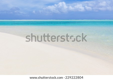 perfect tropical beach, turquoise lagoon and sand bar at aitutaki island, cook islands - stock photo