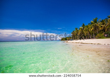 Perfect tropical beach with turquoise water and white sand beaches in Boracay - stock photo