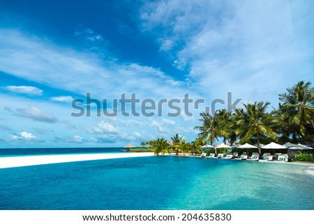 Perfect tropical island paradise beach and pool - stock photo