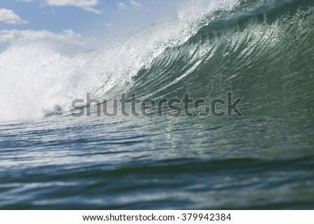 Perfect Wave/ a close up of a perfect surfing wave tubing