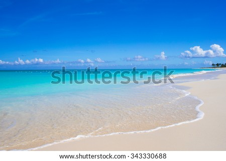 Perfect white beach with turquoise water at ideal island - stock photo