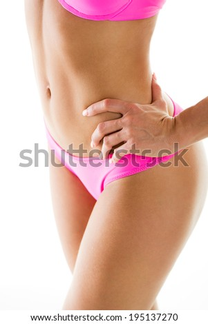 Perfect Woman body in a bikini. Close-up. Isolated on white background. - stock photo