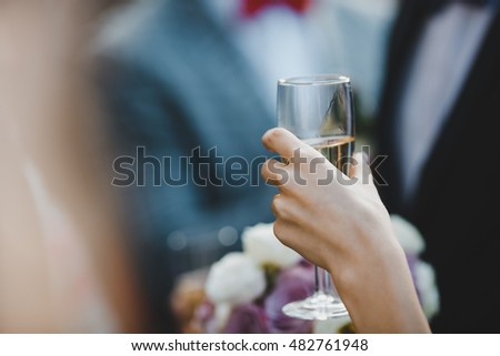Perfect woman's hand holds cold champagne flute
