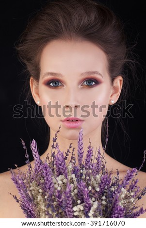 Perfect Woman with Flowers on Black Background - stock photo