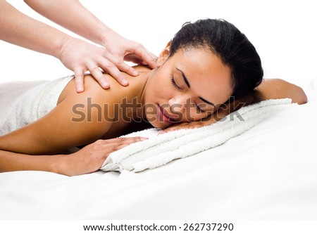 perfect  women with closed eyes receiving massage in a spa center - stock photo