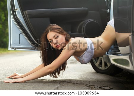 Perfect young woman lying on the road - stock photo