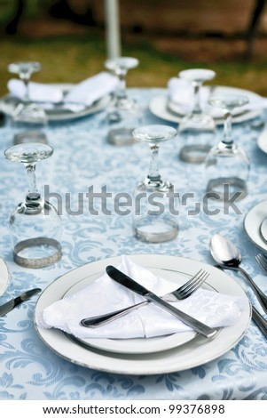 perfectly decorated table setting with wine glass - stock photo