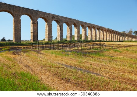 Perfectly kept Roman antique aqueduct in the north of Israel