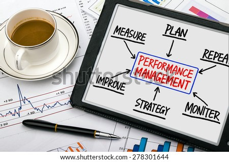 performance management flowchart concept hand drawing on tablet pc - stock photo