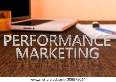 Performance Marketing - letters on wooden desk with laptop computer and a notebook. 3d render illustration. - stock photo