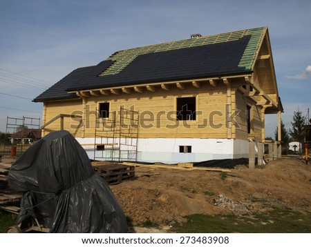 performance of ceramic tiled roof for a wooden house - stock photo