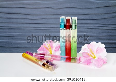 perfume bottle and flower with wooden wall background