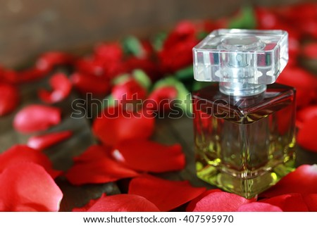 perfume bottle and petals - stock photo