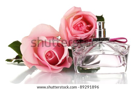 Perfume bottle and two pink rose isolated on white