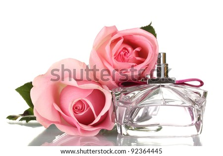 Perfume bottle and two pink rose isolated on white - stock photo