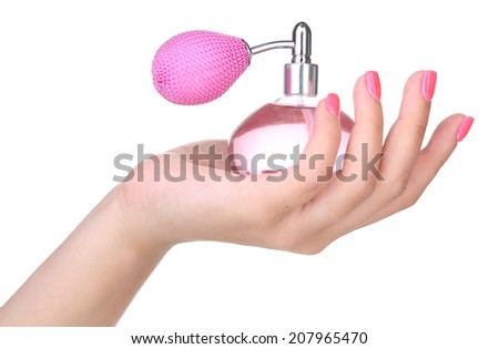 Perfume bottle in hand isolated on white - stock photo