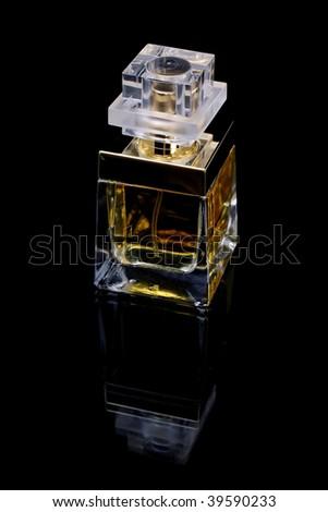 Perfume bottle over black background - stock photo