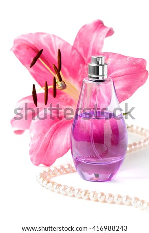 perfume bottle with flower and beads on a white background