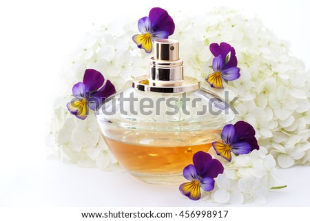 perfume bottle with flowers on white background
