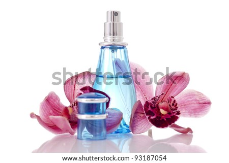 Perfume Bottle with Orchids - stock photo