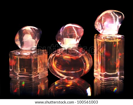 Perfume bottles isolated on black background.