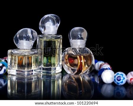 Perfume bottles on black background. - stock photo
