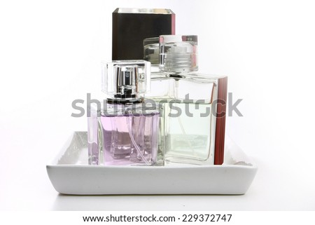 perfume bottles on white porcelain tray