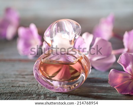 Perfume bottles with flowers on blure background. - stock photo