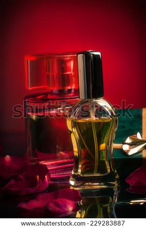 Perfume bottles with rose petals and a gift box