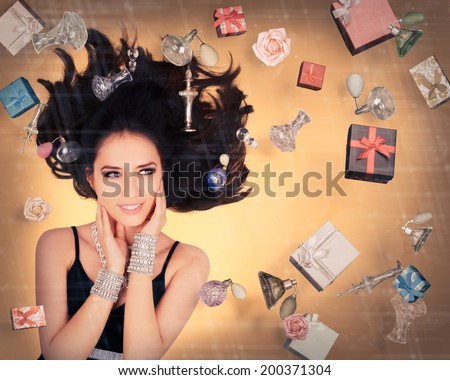 Perfume Fantasy in Zero Gravity - Beautiful young woman surrounded by floating perfume bottles in a glamour portrait   - stock photo