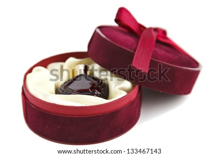 perfume in a velvet box on a white background