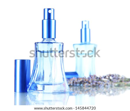 Perfume in bottles and lavender isolated on white - stock photo