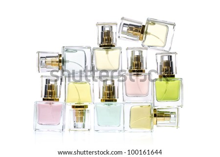 Perfume in bottles over white background - stock photo