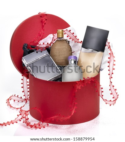 Perfumes in a red festive gift box - stock photo