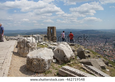 PERGAMUM, TURKEY - May 24, 2014 - Tourists explore the steeply sloping ruins of the Greek theater at  Pergamum above Bergama, Turkey