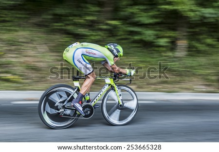 PERIGEUX,FRANCE-JUL 26: Panning image of the Polish cyclist Maciej Bodnar  (CannondaleTeam) pedaling during the stage 20 ( time trial Bergerac - Perigueux) of Le Tour de France 2014.  - stock photo