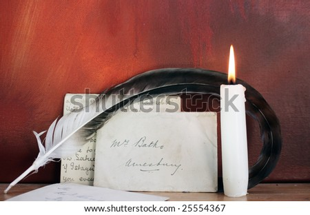 Period set up of a letter,quill pen and lit candle set on top of a wooden mantle against a red grunge background. All props recreated by self as artist. - stock photo