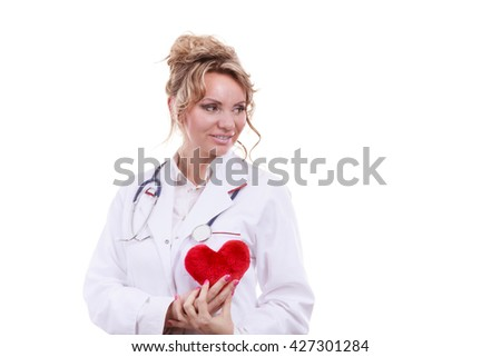 Periodic examinations. Cardiology concept. Female cardiologist holding red heart. Middle aged doctor with stethoscope and white medical apron uniform. Isolated on white. - stock photo