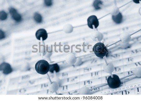 Periodic table of chemical elements with molecule - stock photo
